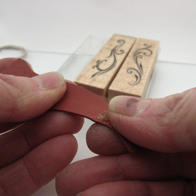 Removing glue from rubber stamp