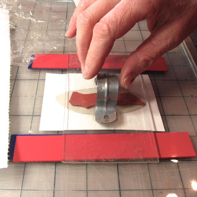 Pressing Rubber Stamp into clay